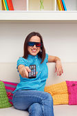 Smiley woman watching 3d film — Stock Photo
