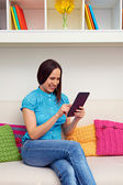 Woman working with tablet computer — Stock Photo