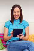Young woman holding tablet pc — Stock Photo