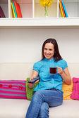 Smiley woman watching tv — Stock Photo
