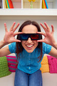 Woman in 3d glasses sitting on sofa — Stock Photo