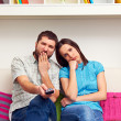 Bored couple watching TV — Stock Photo
