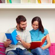 Couple looking at the book — Stock Photo #22169905