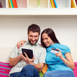 Stock Photo: Couple making purchases on Internet