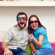 Stock Photo: Couple watching comedy and laughing