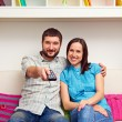 Couple watching TV and resting — Stock Photo #22169961
