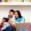 Happy couple sitting on sofa  — Stockfoto