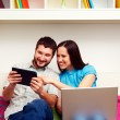 Happy couple sitting on sofa — Stock Photo