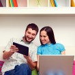 Man and woman looking at the tablet pc - Stock Photo