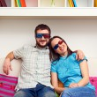 Stock Photo: Smiley couple in stereo glasses