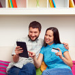 Successful couple making purchases on the internet - Stock Photo