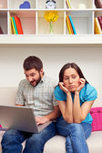 Bored woman sitting while her boyfriend — Stock Photo