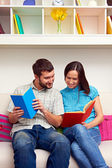 Couple looking at the book — Stock Photo
