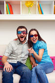 Couple watching comedy and laughing — Stock Photo