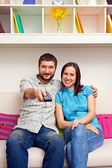 Couple watching TV and resting — Stock Photo