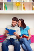 Wife and husband reading the book — Stock Photo