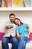 Wife with husband watching TV — Stock Photo