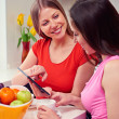 Girls using tablet pc at home — Stock Photo #22467563