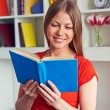 Pretty woman reading the book — Stock Photo