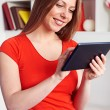 Woman working with tablet pc at home - Stock Photo