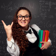 Student showing sign of the horns — Stock Photo #23964393