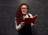 Student over chalkboard with formulas — Stock Photo