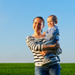 Happy and smiley mother with her little son — Stock Photo