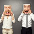 Man and woman holding with excited faces — Stock Photo