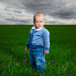 Serious little boy standing — Stock Photo