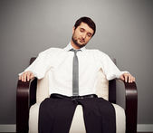 Fatigued businessman on the armchair — Stock Photo