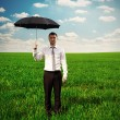 Serious man holding black umbrella — Stock Photo