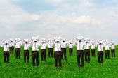 Businessmen hiding their faces — Stock Photo