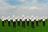 Crowd of businessmen with question mark — Stockfoto