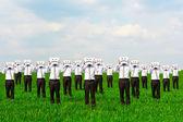 Men hiding their faces behind sad sing — Stock Photo