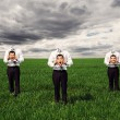 Faceless men standing on the green field — Stockfoto