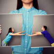 Woman holding the lacerated photo of couple — Stock Photo