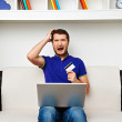 Young man spend all his money in internet — Stock Photo #25959053