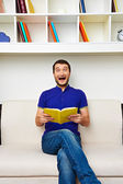 Man holding the book and screaming — Stock Photo