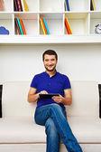 Man sitting on sofa — Stock Photo