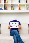 Faceless man sitting on sofa — Stock Photo
