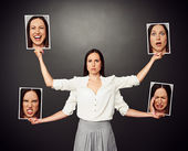 Woman holding pictures with different mood — Stock Photo