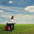 Man working with laptop on field — Stock Photo #30006085
