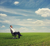 Man resting on the green field — Stock Photo