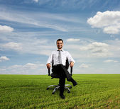 Boss sitting on chair at outdoor — Stock Photo