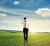 Unsuccessful man standing on the field — Stock Photo