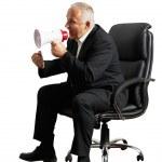 Angry senior boss screaming at megaphone — Stock Photo #32849527