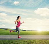 Runner woman jogging — Stock Photo