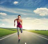 Concentrated woman running — Stock Photo