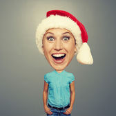 Funny christmas girl in red hat — Stock Photo