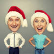 Excited couple in santa hat — Stock Photo